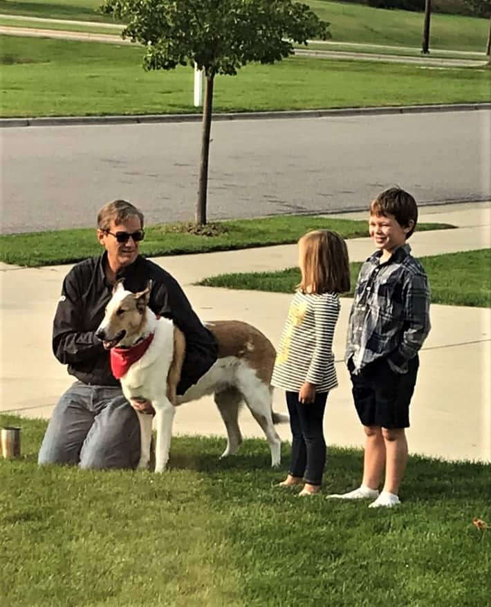 Tag stands outside with Wade, Parker, and Lucy