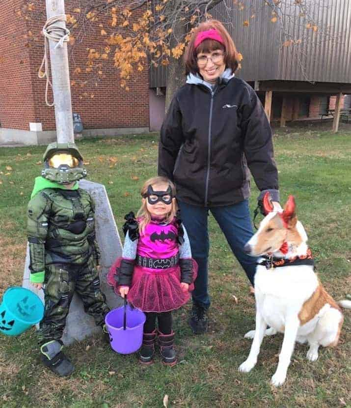 Veleda outside with Parker in a G.I. Joe costume, Lucy as a princess, and Tag wearing devil horns