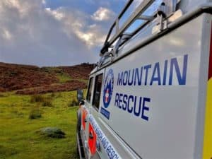 "the side of an emergency vehicle heading into the foothils reads ""Calder Valley Mountain Rescue"