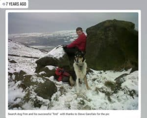 Finn poses before the dogsbody he found hiding in a snowy rock pile